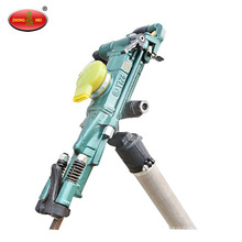Hand operated pneumatic rock drill