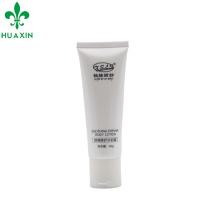 Tubo plástico da cara cosmética branca matte 100ml com o tampão especial da aleta