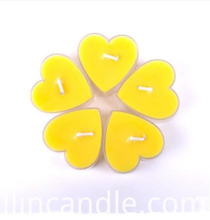 yellow heart tealight candle