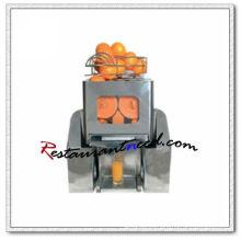 Exprimidor de naranja automático K619 sobre encimera