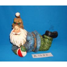 Resina colocando Papai Noel para decoração de natal