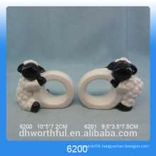 Simple ceramic paper napkin ring with lamb figurine