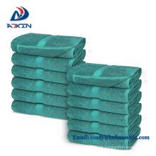 O hotel fornece a toalha relativa à promoção barata 30x30 do hotel da mão da cor sólida