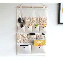 Organizador de almacenamiento para colgar en la puerta de la pared de tela de algodón con 12 bolsillos y 2 ganchos para armarios en casa