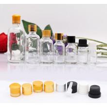 Botella de vidrio de aceite esencial transparente (NBG02)