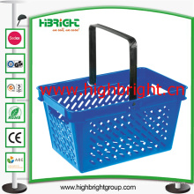 Cesta de compras plástica da mão do supermercado para a mercearia