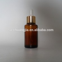 cosmetic packaging 30ml amber essential oil glass bottle with gold aluminium dropper dropper bottle