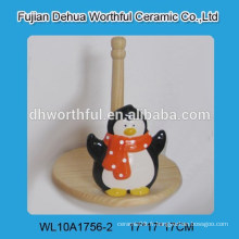 Support de tissu en céramique vif avec forme de pingouin