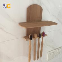 Suporte de escova de parede de bambu montado na parede
