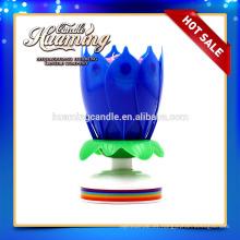 Vela de la flor con la vela de la música / de la torta de cumpleaños