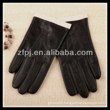 fashion lady wearing smartphone leather touch glove