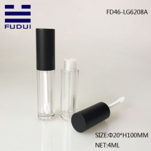 Small transparent cosmetic lipgloss tube with brush