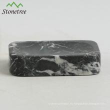 Jabonera de piedra natural con baño de mármol accesorio.