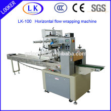 Horizontal flow wrapping machine for food packaging