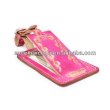 Etiqueta de equipaje de cuero rosa