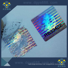 Silberfarbener leicht beschädigter Hologramm-Aufkleber