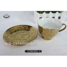 Xícara de chá de cerâmica banhado a ouro e conjuntos de pires
