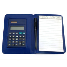 Calculatrice solaire avec notes collantes et stylo