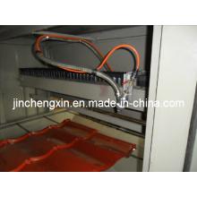 Máquina para tejas revestidas con virutas de piedra