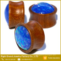 Organic Wood Saddle Ear Plugs With Big Blue Synthetic Fire Opal Centered Wood Ear Gauges