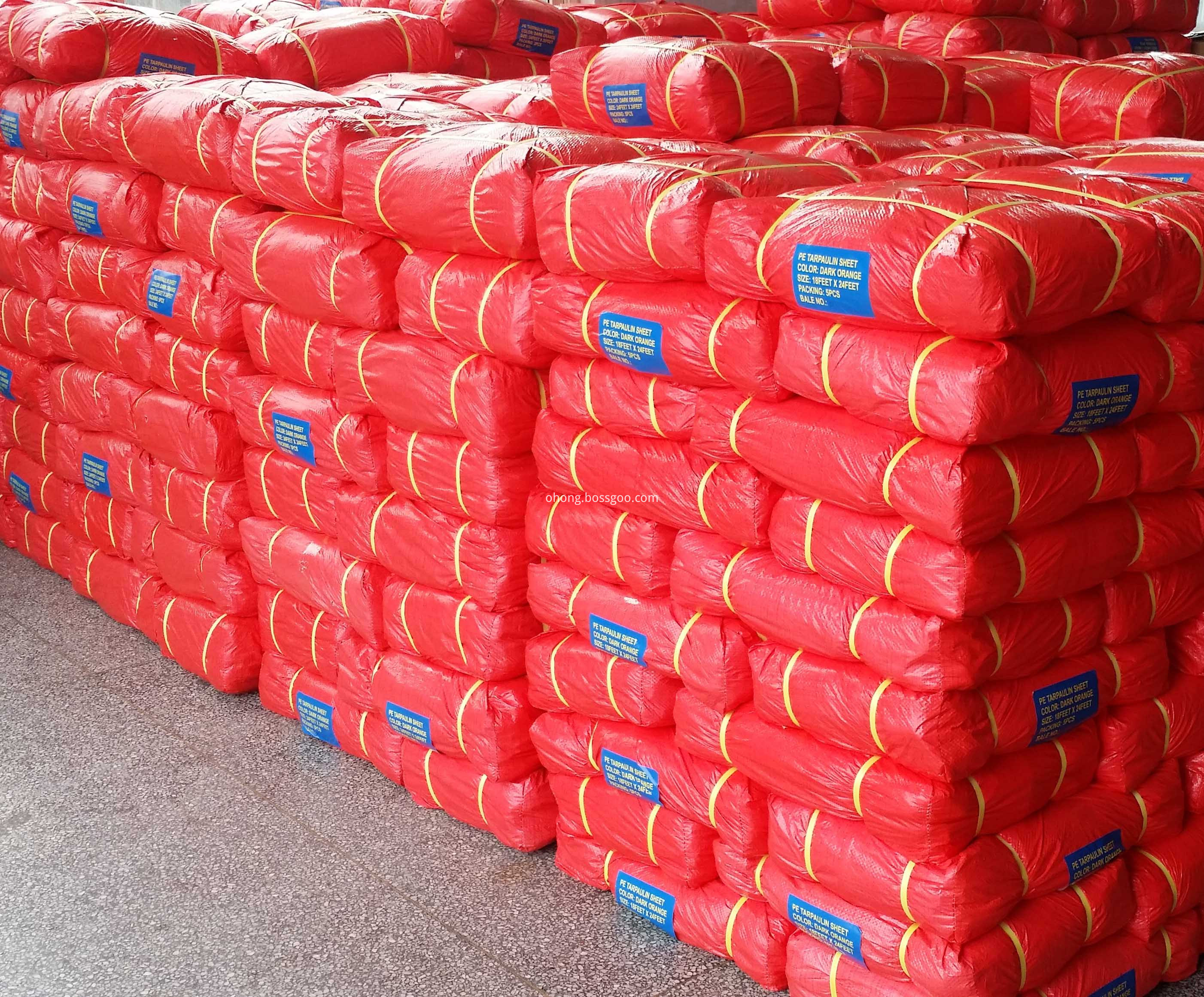 Orange Tarpaulin Bale Packing