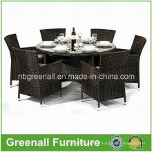 Ensemble de table ronde et de chaises à manger en rotin