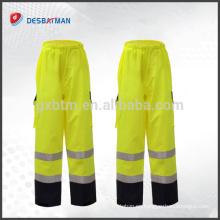 Pantalones de trabajo de la cinta reflectante de los pantalones de seguridad impermeables profesionales de alta calidad con 2 bolsillos