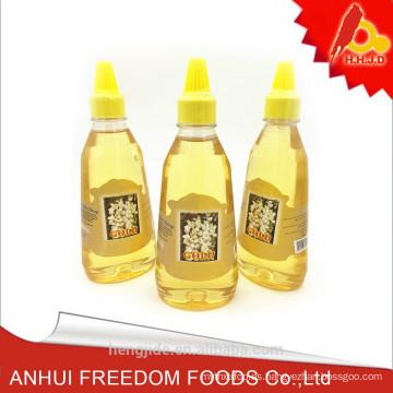 miel de acacia madura natural pura envasada en una botella de plástico de 500g