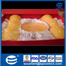 Acción para la promoción amarillo vitrificó las tazas y los platillos de China de hueso
