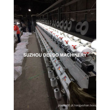 Bobinador enrolando na indústria têxtil