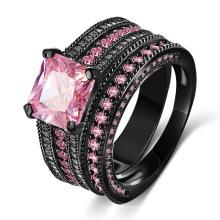 Bague fourrée en or rose 18 ct avec diamants noirs
