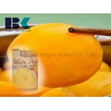 La exportación de melocotón amarillo en almíbar