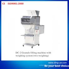 Machine de remplissage de granules avec système de pesée (deux pesées)