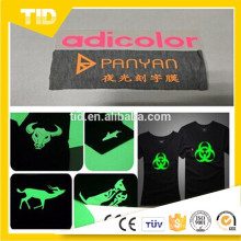 Heat resistant glow in the dark transfer film for clothing