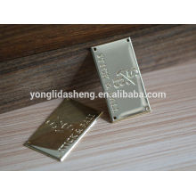 China clothing accessory custom made gold engraved metal label logo