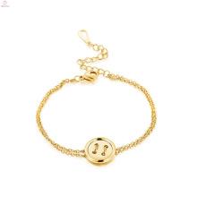 Braceletes delicados do ouro das mulheres do prendedor do encanto da joia