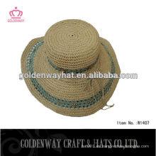 Grandes sombreros de paja de papel de playa floja para el verano