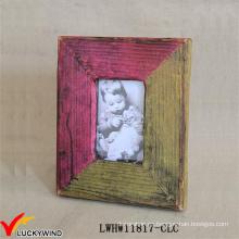 Colores que hacen juego el marco de madera hecho a mano de la foto del diseño