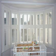 indoor white painted wood wooden plantation shutters