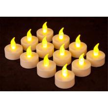 O Tealight ambarino a pilhas do diodo emissor de luz Candles Wickless de cintilação sem calor sem chama