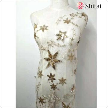 Star designs with beaded embroidery sequins fabric