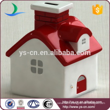 White and red ceramic house coin bank