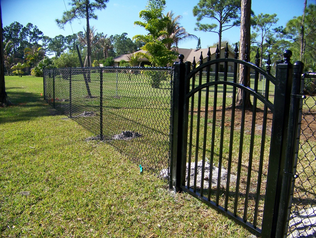 chain link fencing and picket gate