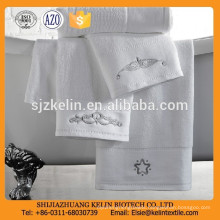 Plain white super soft 100% cotton hotel towel with fancy embroidered