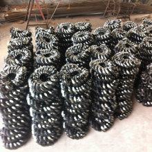 Raspador de transporte y anillo de enlace abierto usados en la mina
