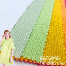 Free sample Hot Sale Customized tricot polyester warp knitting seersuker cheap europe textiles varley fabric for garment