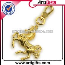 Porte-clés en métal plaqué or strass cheval