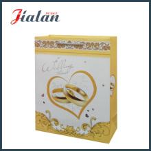 De gama alta para el anillo de oro de compras de la boda Bolsa de papel de regalo