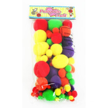 kid playing bright color craft pom pom