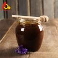 Mature pure black seed bee honey